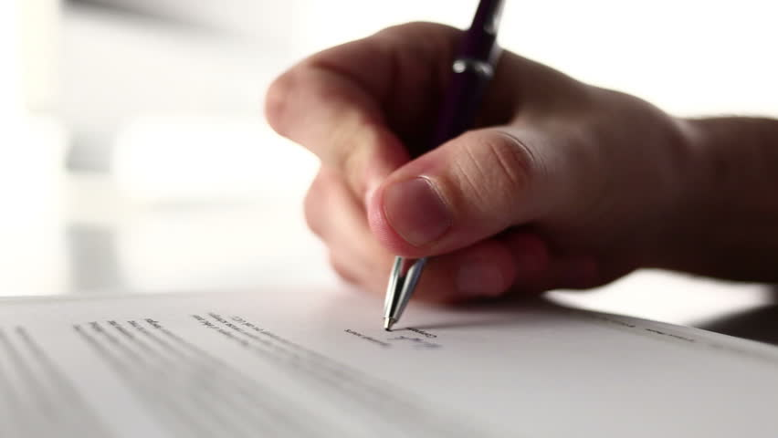 A male hand signing a form.  - HD stock video clip