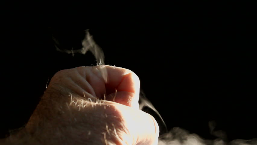 Hand forms fist, squeezes, releases, smoky vapors. 1080p - HD stock footage clip