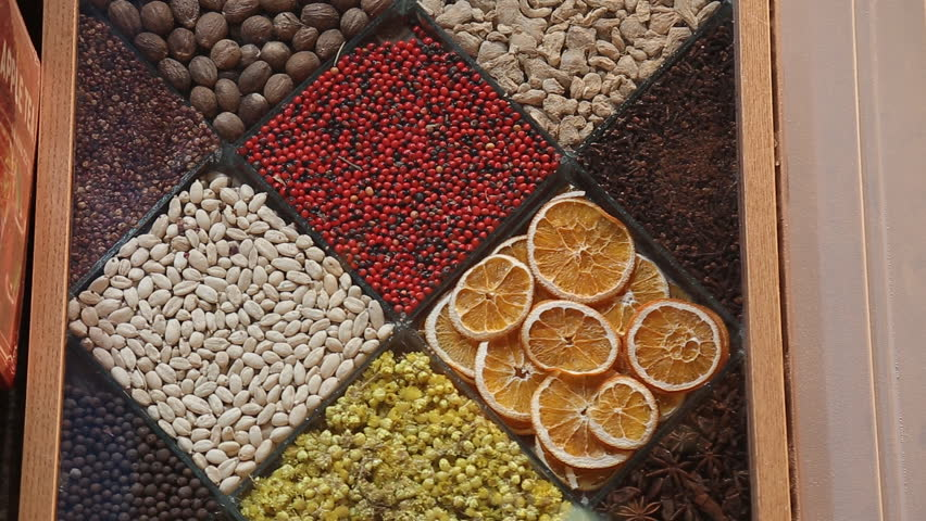 Image of market offering a selection of dried fruits and baklava.