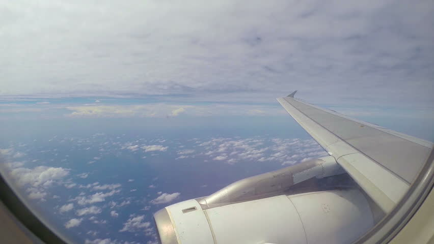 Beauty sky. Plane above the ocean and under the clouds.