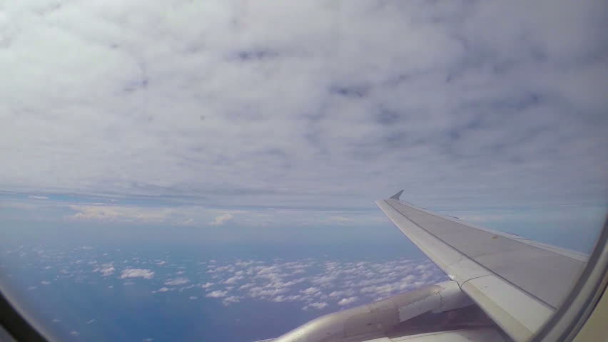 Plane flight above white clouds.Blue sky on background.