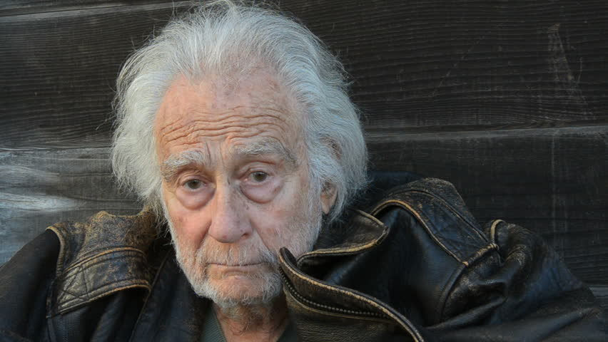 Homeless senior Man in an alley
