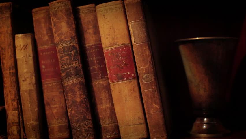 Ancient books in a bookshelf - HD stock video clip
