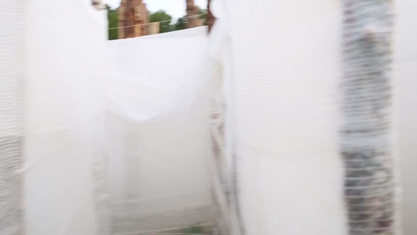 White maze with fabric walls outdoor at summer. Inside view