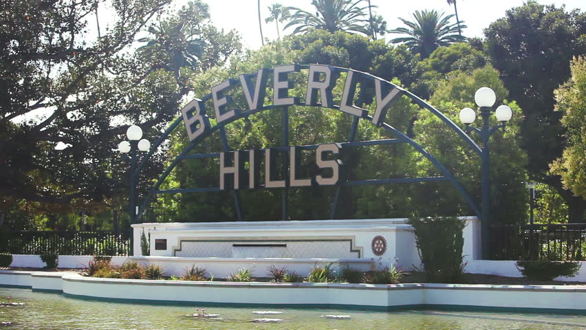 LOS ANGELES, USA - JUNE 15, 2015 Beverly Hills Sign, Trees, Street Sign, Los Angeles, California