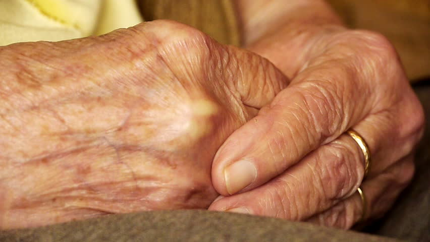 Senior old woman young man hold hand wrinkle skin close up