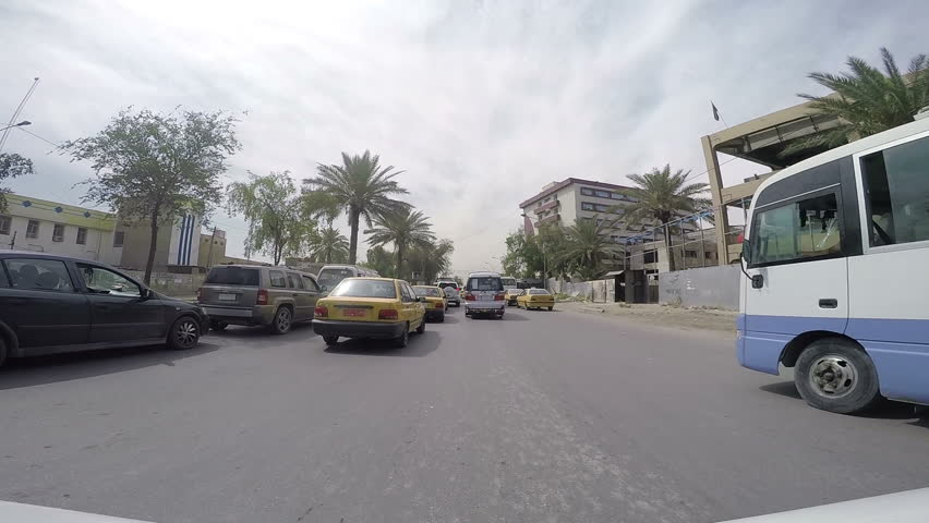 BAGHDAD, IRAQ - MAY 2015: Time lapse of driving POV through an army checkpoint in baghdad, Iraq