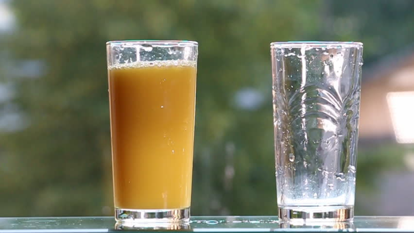 Orange juice on the table,on green background.