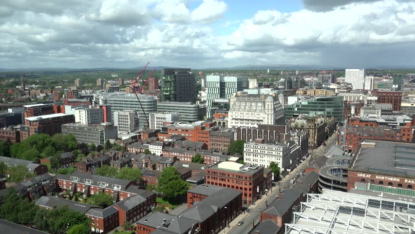 ULTRA HD 4K Timelapse of cloud pass and traffic street in Manchester, tourism attraction by day