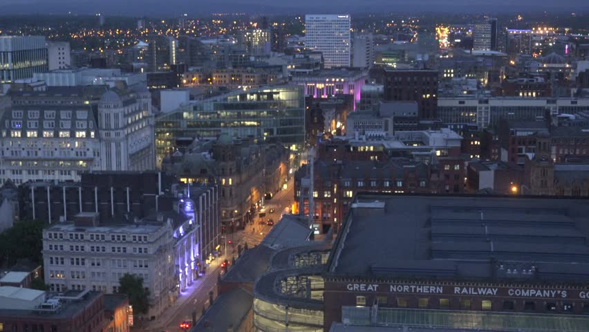MANCHESTER - ENGLAND, MAY 28, 2015, ULTRA HD 4K Aerial view of traffic street on busy avenue by day