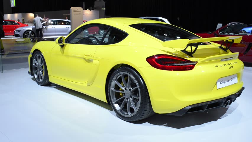 AMSTERDAM, THE NETHERLANDS - APRIL 16: Yellow Porsche Cayman GT4 sports car rear view at the 2015 Amsterdam motor show. The GT4 is the more powerful version of the Porsche Cayman.