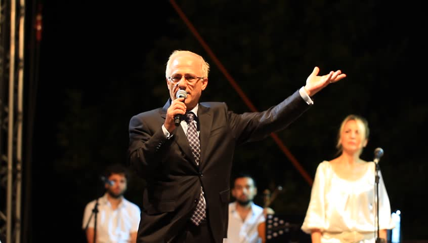 ISTANBUL - JUL 14, 2012: Maltepe Mayor Mustafa Zengin gives a speech on open-air stage at Maltepe