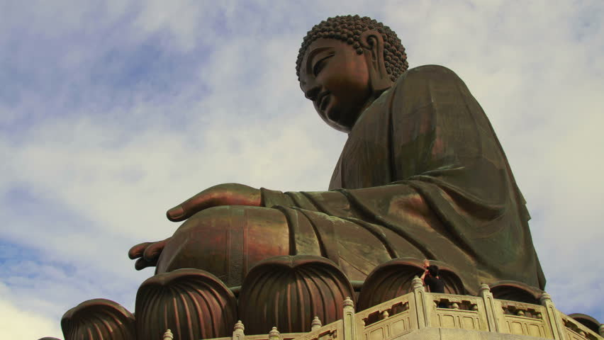 HONG KONG - CIRCA 2012: Tian Tan Buddha, also known as the Big Buddha, is a large bronze statue of a Sakyamuni Buddha, completed in 1993, and located at Ngong Ping, Lantau Island, in Hong Kong