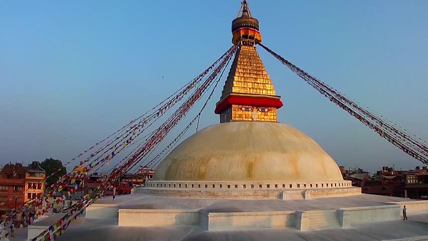 KATHMANDU, NEPAL - NOVEMBER 2, 2015: The Boudhanath Stupa just before sunset on November 2, 2013 in Kathmandu, Nepal. The stupa survived the massive earthquake of 25 April, 2015. - HD stock footage clip