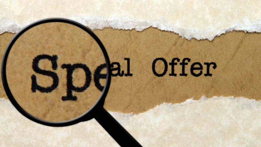 Magnifying glass on special offer text