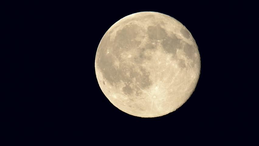 Full moon going across the frame