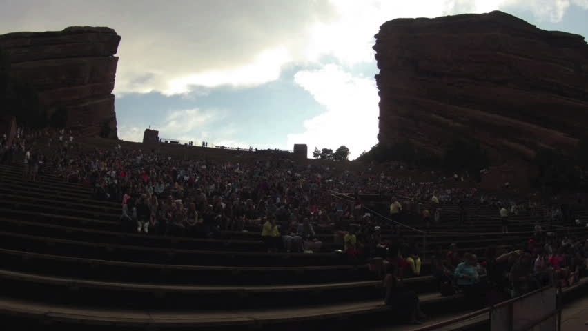 MORRISON, COLORADO CIRCA JUNE 2014. A Time lapse of a crowd gathering to watch concert at Red Rocks venue during sunset. The design of the Amphitheatre consists of two, three hundred-foot monoliths.