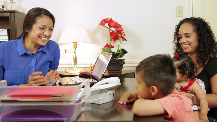 Cheerful CEO or small business owner makes client and her children feel welcome. - HD stock footage clip