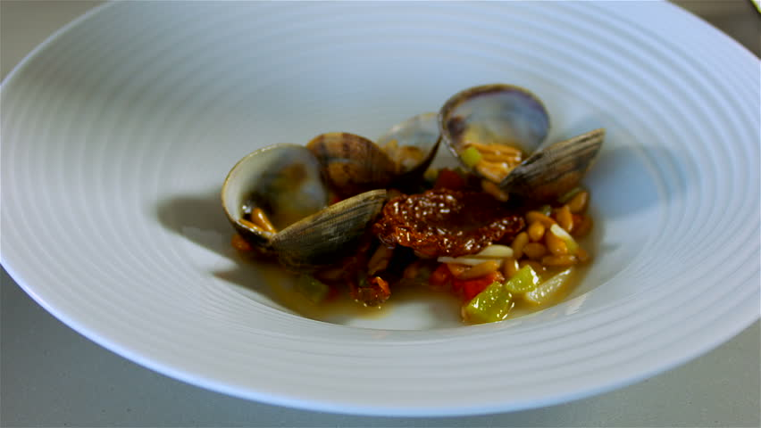 Gourmet cooking bass fish with clams prepare and cook the for Bass fish cooking