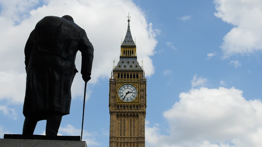Tourists time lapse pass Churchill statue and Big Ben. London, UK. July 2015