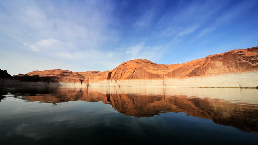 Still waters of Lake Powell in Arizona with the sandstone rock showing clear signs of dropping water levels  - HD stock footage clip