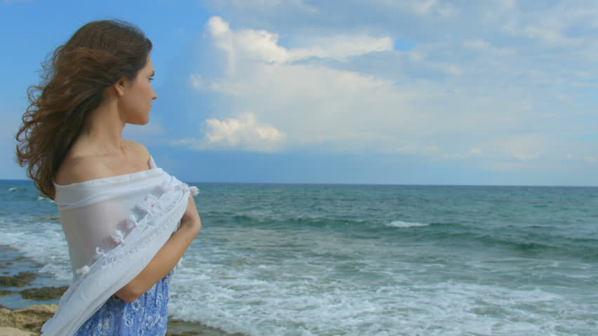 Lonely woman on beach ...