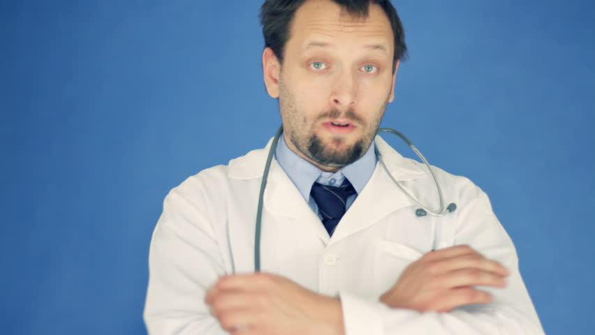 Unhappy doctor with crossed hands, on blue background - HD stock video clip