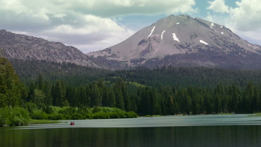 Lassen Volcanic National Park, California, United States of America – July, 2015: Two people paddle a Kayak on Manzanita Lake with Lassen Peak in the background.