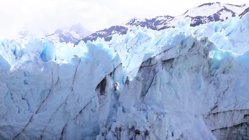 Iceberg falls from ice shelf.