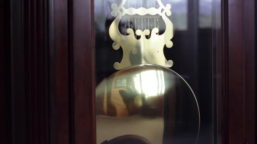 Pendulum on grandfather clock - HD stock footage clip