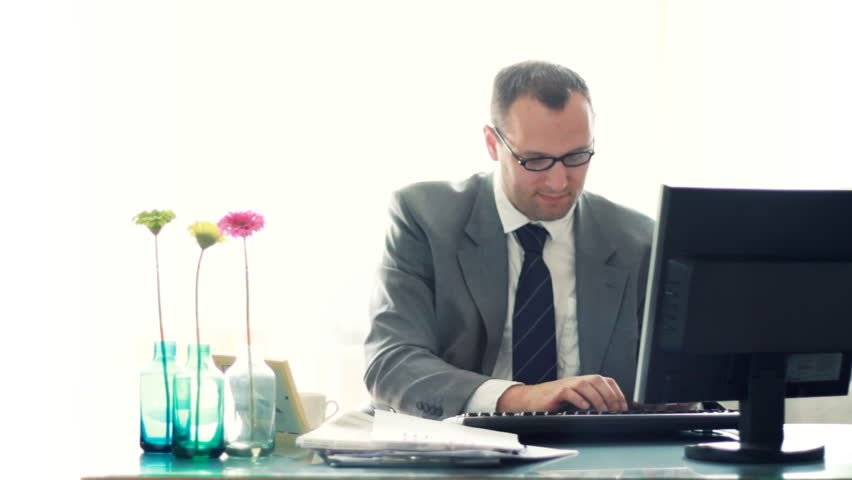 Portrait of happy young smiling businessman in the office - HD stock footage clip