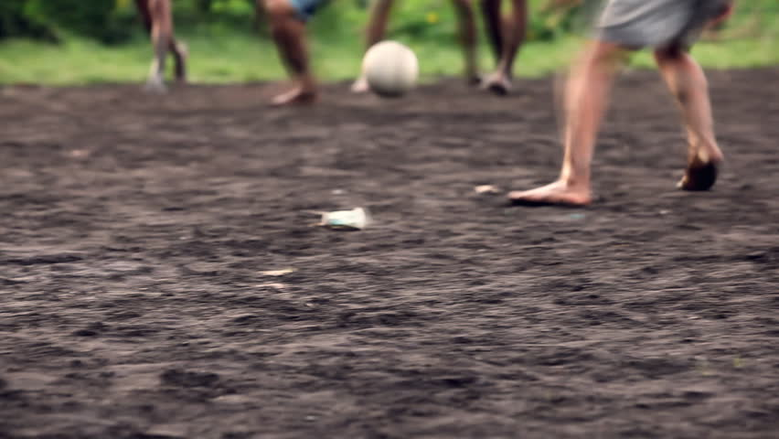 A gang of bar feet kids playing soccer on a muddy field. Serial of slow motion shots with depth of field effects. Action loaded details of running legs and goal shots. [b]HD1080 | 30fps[/b] - HD stock video clip