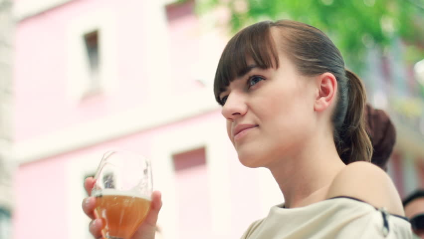 Woman drinking beer outdoor - HD stock video clip
