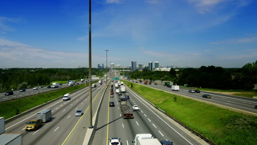 Wide angle View of King's Highway 401 near Toronto in Ontario Canada. The part of Highway 401 that passes through Toronto is the busiest highway in the world. - HD stock video clip