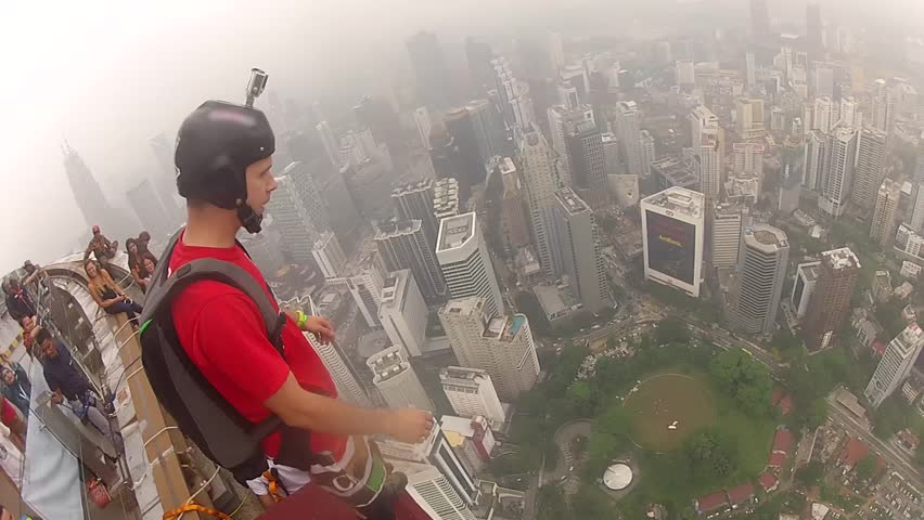 Man jumping off 300 meters building and doing in free fall slow and spectacular double back flip (double gainer) then deploy his parachute