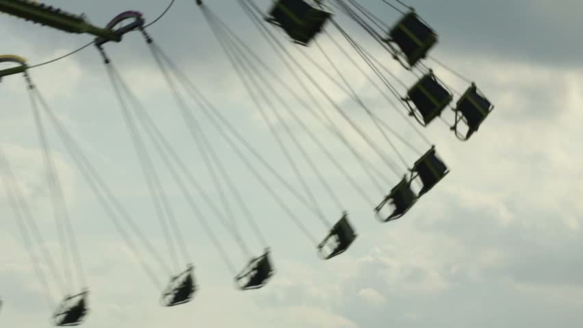 Carnival swings with sky in background - HD stock video clip