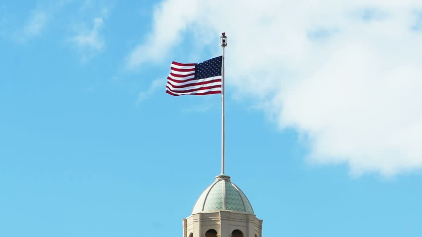 Wind Blowing On Building : American flag on building blowing in wind stock footage