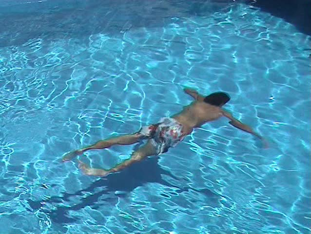 Youngster swimming in the swimming pool - SD stock video clip