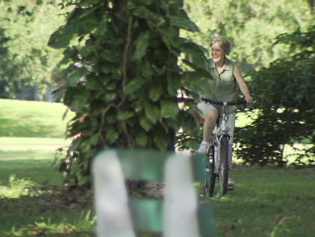 Mature Couple Riding Bike - SD stock video clip