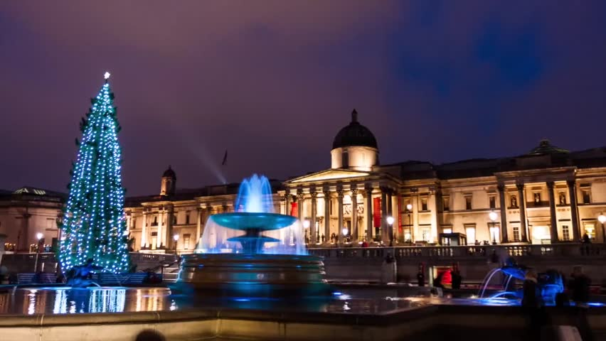 Time Lapse of fountain on Trafalgar Square at Christmas in London, UK. Trafalgar Square is the most famous and beautiful square in London.