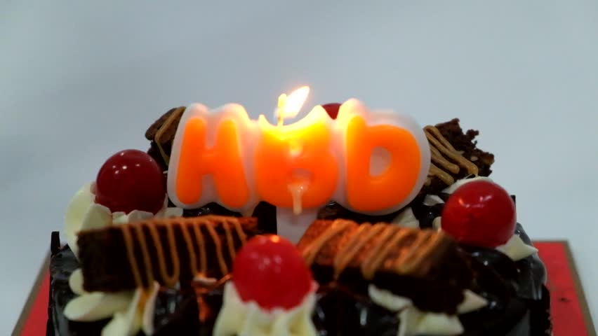 Candles on the birthday cake - HD stock video clip