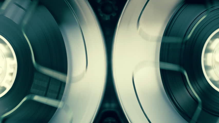Rotation reel with tape on the video, audio tape recorder / player. Closeup. Shallow depth of field