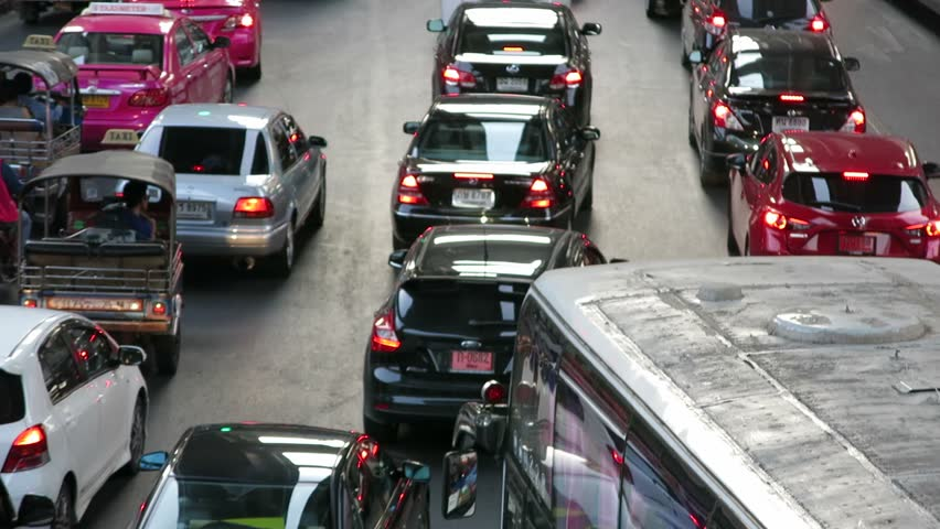 Bangkok, Thailand - May 2, 2014: Traffic in Siam Area of Bangkok, Thailand. There are many cars on the road.
