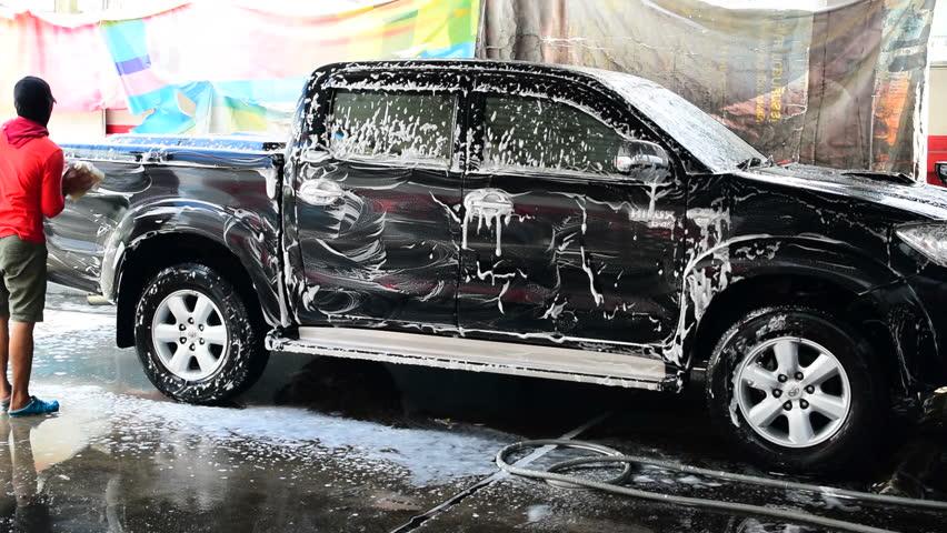 Bangkok,Thailand-November 14,2015:One employee was washing a truck with foam.