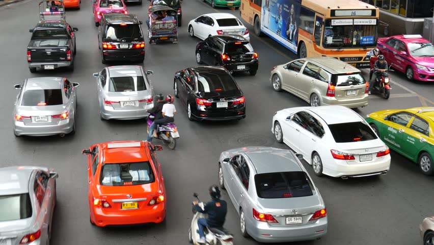 Bangkok, Thailand - September 6, 2015: Cars are on the road near Siam of shopping mall areas. There are traffic jams during rush hour.