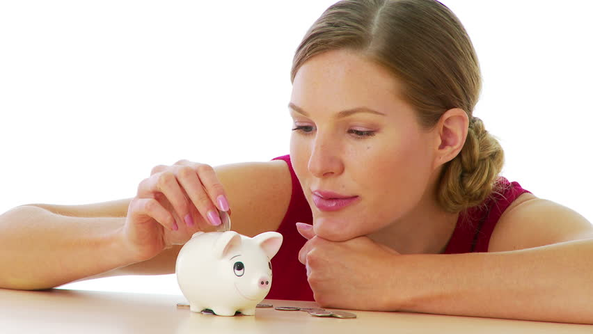 Woman putting money in piggy bank - HD stock video clip