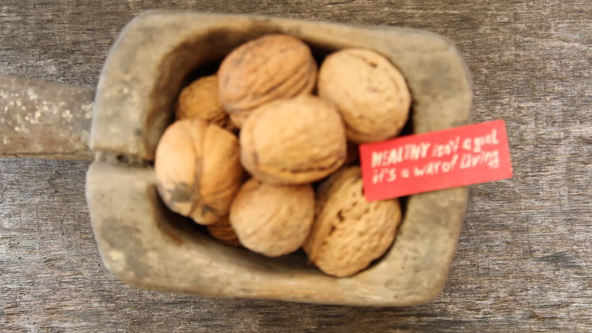 Healthy isn't a goal. it's a way of living - inscription on the label and and walnuts. Healthy lifestyle concept.