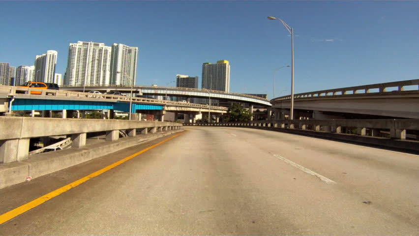 MIAMI, FLORIDA - AUGUST 4: Vehicle POV, driving the highway near Downtown Miami, August 4th, 2011 in Miami, Florida.