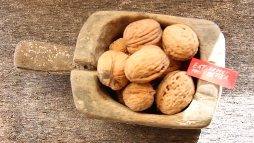 Eat Better Feel Better - inscription on the label and and walnuts. Healthy lifestyle concept.