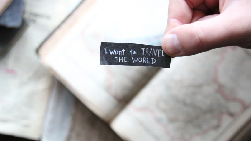 """""""i want to travel the world""""  inscription on the label, on the background old map"""